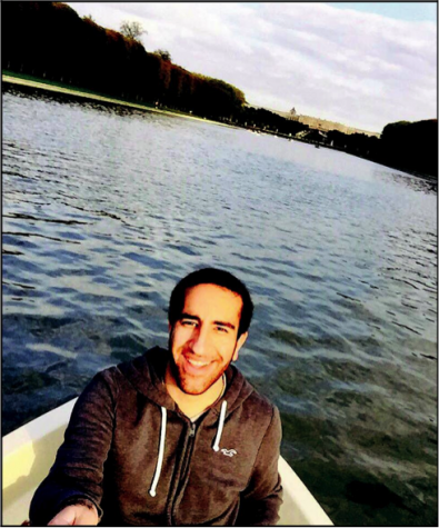 Junior Wasim Gendi boating on a pond in the Palace of Versaille's gardens.