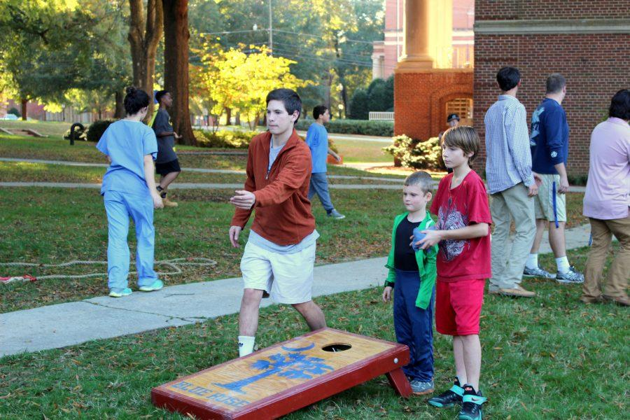 Corn hole is one of the many popular games kids played at the carnival.