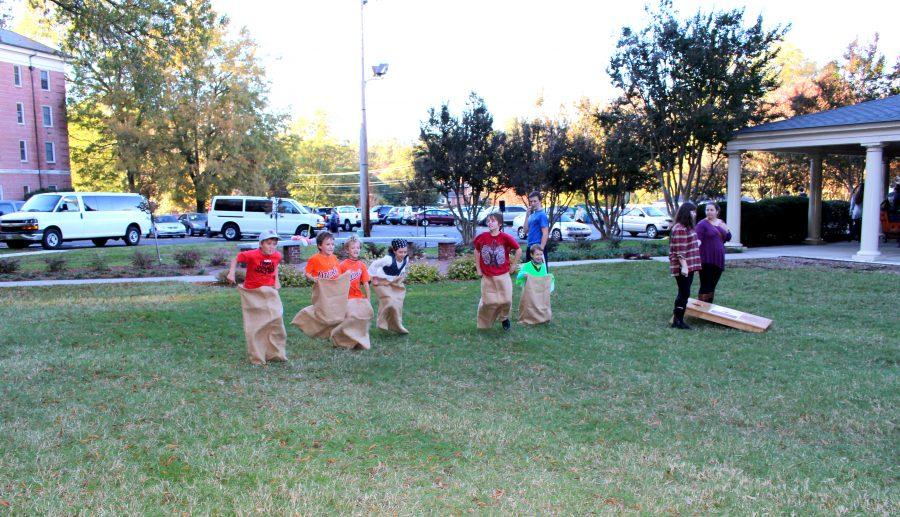 Kids race for the finish line in a sack race.