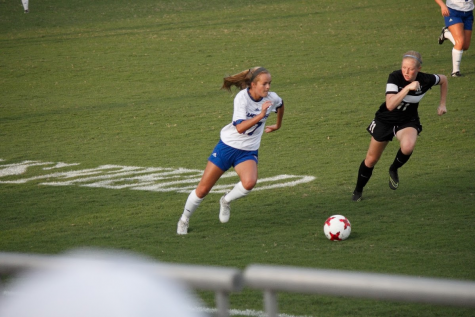 Freshman Morgan Hutchison vies for the ball at the August 27 Wofford match.