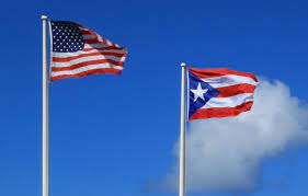 The Puerto Rican and American flags together represent mixed heritage for the LatinX community, according to Dr. Javier Ávila.